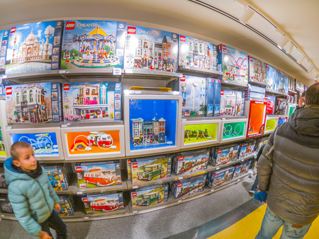 Bologna, Italy - December 6, 2018: the famous constructions toy bricks, Lego shop of Bologna. Store full of people for the recent inauguration.