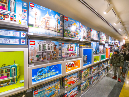 Bologna, Italy - December 6, 2018: rows of new lego sets at the opening of Lego toys store of Bologna. Store full of exclusive Lego boxes.