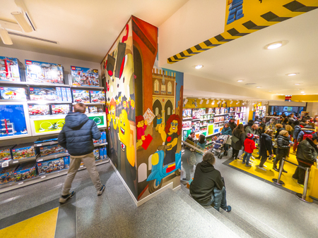 Bologna, Italy - December 6, 2018: ground floor interior of the Lego store of Bologna, selling Lego bricks. In Via Indipendenza street with people shopping for toys. Editorial
