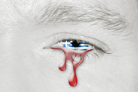 Crying bloody eye with Greece Flag iris. Concept of sadness for Greek pain about financial crisis, austerity, financial planning and patriotic metaphor.