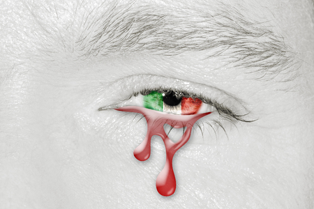 Crying bloody eye with Italy Flag iris. Concept of sadness for Italian pain about financial crisis, austerity, financial planning and patriotic metaphor.