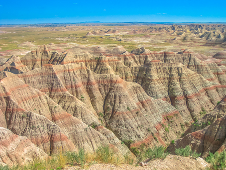 Hay Butte Overlook at Badlands National Park, United States. Eroded rugged peaks in a sunny day with blue sky. Popular american travel destination in South dakota.