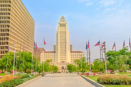 Front view of Los Angeles City Hall and Civic Center buildings in Downtown of LA. The building is home to the government and mayor of city of Los Angeles, California, United States. Urban cityscape.