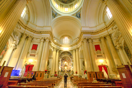 Bologna, Italy - January 12, 2018: central nave interior of Madonna of San Luca Sanctuary with icon of the Madonna with the child in the distance.