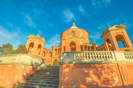Entrance of Sanctuary of Madonna di San Luca in a sunny day with blue sky. Basilica church of San Luca in Bologna, Emilia-Romagna, Italy. Famous landmark cityscape. 스톡 콘텐츠