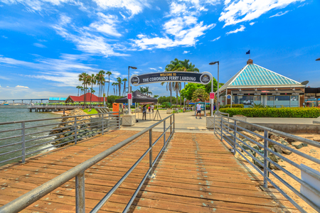 San Diego, California, United States - August 1, 2018: tourist attraction of wooden boardwalk Coronado Ferry Landing leading to Coronado Island coastal beach in San Diego Bay.Travel summer destination