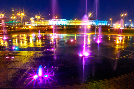 Colorful water fountain at Souq Waqif Park at Doha Corniche illuminated at night. Famous tourist attraction in Doha. Qatar, Middle East, Arabian Peninsula in Persian Gulf. Reklamní fotografie