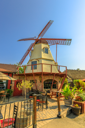 Old Windmill in a sunny day with blue sky. Santa Ynez Valley, California, United States. Solvang is a Danish Village, known for its windmills. Popular travel destination. Vertical shot.