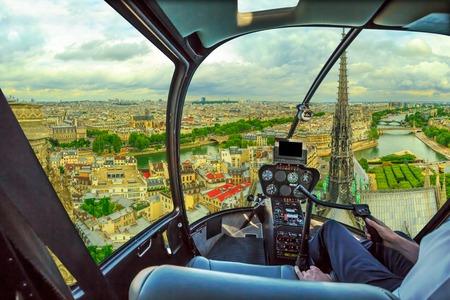 Helicopter cockpit flying on Pont Saint-Michel bridge on Senna river of Paris, French capital, Europe. Scenic flight above Paris skyline.