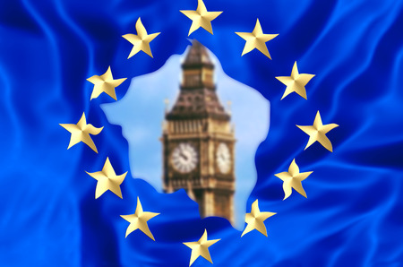 European flag broken by United Kingdom exit with blurred Big Ben tower of London, the house of a British parliament. The financial concept for Brexit and EU division.