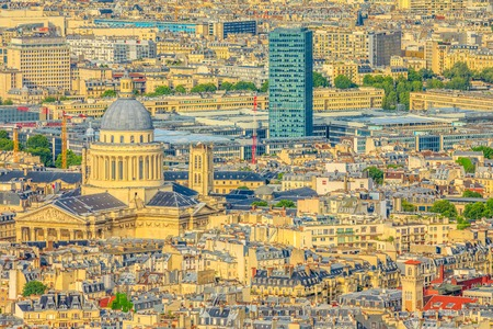 Aerial view of dome of the Pantheon at sunset light from panoramic terrace of Tour Montparnasse. Paris urban skyline and cityscape. Capital of France in Europe.