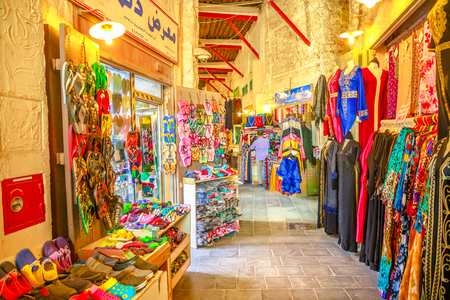 Doha, Qatar - February 17, 2019: covered part traditional Eastern Souq Waqif, best location for tourists in Doha and noted for selling traditional garments, spices, handicrafts and souvenirs.