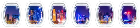 Porthole frame windows on Skyline of Doha city of Qatar in the harbour at blue hour. Night scene waterfront in Doha bay with copy space for Banner panorama.