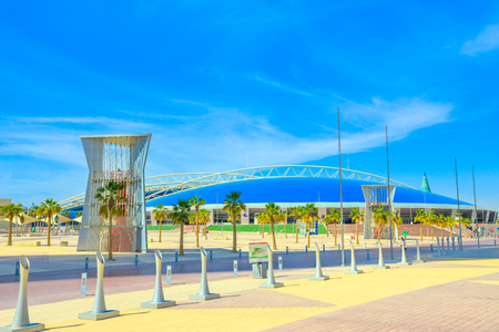 Doha, Qatar - February 21, 2019: Aspire Dome or Aspire Academy is a sporting academy for youth, located in the center of Aspire Zone in Doha Sports City. Sunny blue sky.