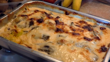baking lasagna with vegetables, cheese and bechamel, boiling hot in an oven. Traditional italian dish. Close up zooming out. Traditional italian dish. Stok Fotoğraf