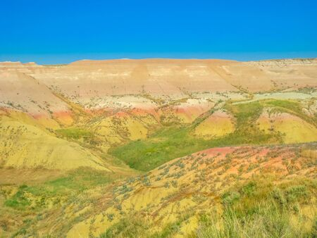 Yellow Mounds Overlook along Loop Road in Badlands National Park, South Dakota, United States. Summer season. Blue sky with copy space.