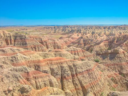 Hay Butte Overlook at Badlands National Park, United States. Eroded rugged peaks in a sunny day with blue sky. Popular american travel destination in South dakota. Copy space.