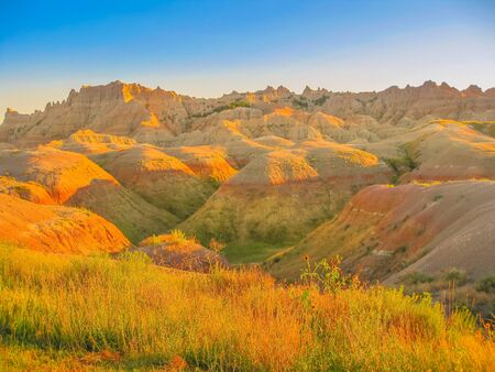 Scenic landscape at sunset of Badlands. Colorful eroded pinnacles of Badlands National Park, United States. Popular american travel destination in South dakota. 写真素材