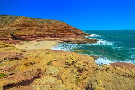 Scenic aerial view of Pot Alley in Kalbarri National Park, Western Australia from Pot Alley lookout. Rugged sandstone, Coral coast in turquoise Indian Ocean. Blue sky with copy space. 写真素材 - 128239175