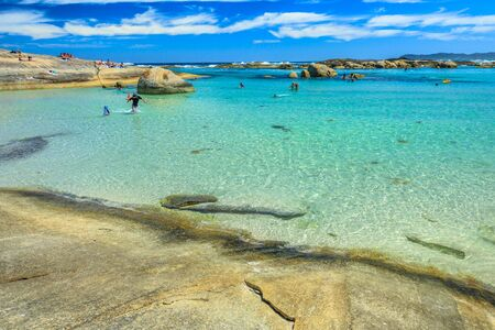 Calm and sheltered waters of Greens Pool in William Bay National Park, Denmark, Western Australia. People swimming in summertime. Popular travel destination in Australia.