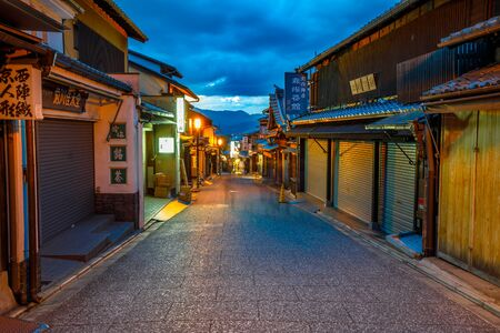 Kyoto, Japan - April 24, 2017: the ancient street of Hanami Lane or Hanamikoji Dori in the Gion District, at World Heritage at dusk. Gion is Kyotos most famous geisha district located in Kyoto, Japan