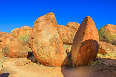 Two naturally split boulder in Karlu Karlu, Northern Territory, Australia. Devils Marbles Conservation Reserve are one of Australias most famous natural wonders. Aboriginal land in Red Centre.