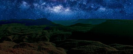 Banner panorama of Blue Mountains National Park by night with milky way, stars field and galaxies. New South Wales, Australia. Stock fotó
