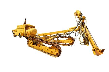 Tracked bulldozer with drilling machine for work along road. Work in progress, industrial machine. Isolated on white background with copy space.