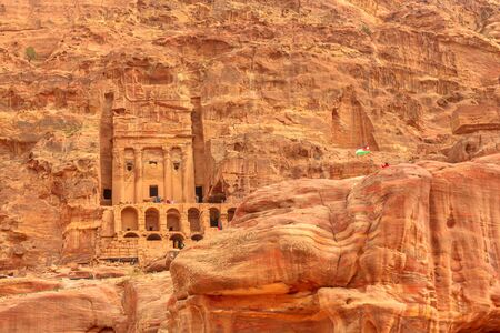 Petra in Jordan. Facade of Roman soldiers tomb so called Urn tomb, the Court, s located in the side of the mountain known as al-Khubta, above Wadi Musa.