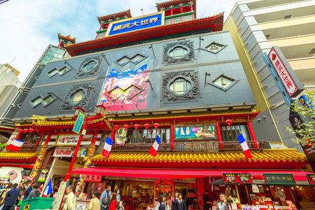 Yokohama, Japan - April 21, 2017: main street Chukagai Odori with chinese buildings and restaurants in heart of historic Yokohama Chinatown, the Japans largest Chinatown. Urban pedestrian street area