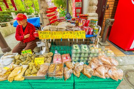 Yokohama, Japan - April 21, 2017: Chinese restaurant street with many standing signboards, drink vending machines and food stores in Yokohama Chinatown, the Japans largest Chinatown, central Yokohama 스톡 콘텐츠 - 143450227