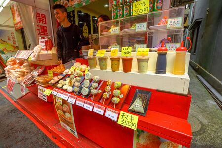 Yokohama, Japan - April 21, 2017: seller in chinese street food with fresh smoothies, typical drinks, fruit drinks, sweets, pastries in Yokohama Chinatown, the Japans largest Chinatown.