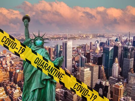 New York City in lockdown for Coronavirus. Yellow quarantine zone barrier above Statue of Liberty with face mask and Manhattan skyscrapers aerial view. United States affected by the Covid-19 pandemic.