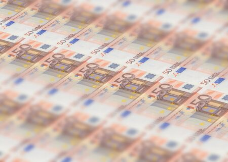 Millions banknotes stack of 50 European euros with Mario Draghi sign, ECB president. Concept of printing money from the European mint and the European Central Bank ECB. First series of 2011-2017.