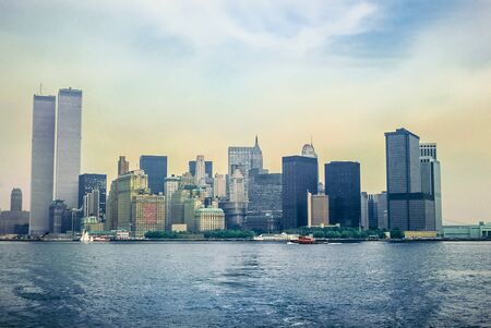 Archival and historical cityscape of New York skyline from Hudson River with World Trade Center featured as landmark of the Twin Towers. Lower Manhattan in NYC, United States.