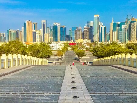 Modern skyscrapers of Doha West Bay skyline view from State Grand Mosque in Doha, Qatar, Middle East, Arabian Peninsula. Long path outdoot the mosque at sunny day. Standard-Bild