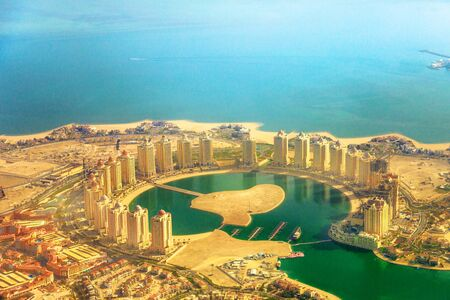 Details of towers of the Pearl-Qatar, the artificial island in Persian Gulf, Doha, Qatar, Middle East. Scenic flight of Viva Bahriya and Bahriya Beach in Moorish style. Aerial view of Doha cityscape.