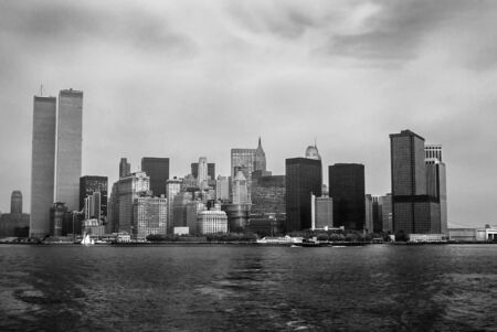 Twin Towers NYC. Archival and historical cityscape of New York skyline from Hudson River with World Trade Center. Lower Manhattan in NYC, United States. Vintage shot in black and white.
