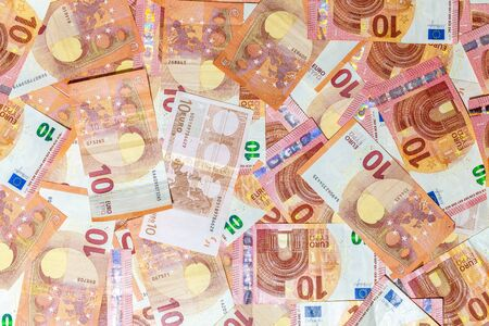 Ten Euro banknotes background of Euro currency in Europe. Financial colorful background. Concept of printing money from the European mint and the European Central Bank ECB.