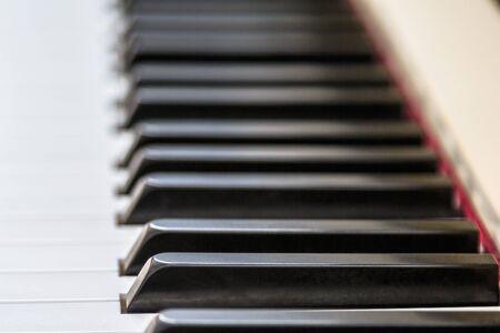 Close-up with shallow DOF of piano keyboard. Digital piano keys playing music. Stock Photo