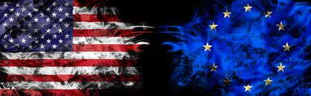 American and European flag in smoke on black background. Concept of conflict and custom duty. America VS Europe metaphor. Dollar Euro exchange currency and international commercial tension and crisis