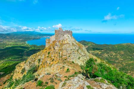 Iconic view of Volterraio Castle on rock at 394 m. Fortress of Volterraio, symbol of Elba Island, dominates Portoferraio Gulf. The never conquered italian castle in all history. Banco de Imagens