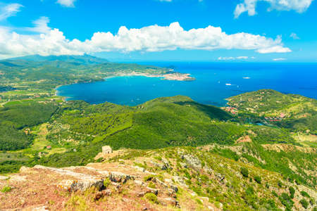 Panoramic view of Portoferraio Gulf, Elba Island, from top of Monte Volterraio on which the fortress dominates north part of island of Tuscany Archipelago, Italy. Church of San Leonardo on background. Banco de Imagens