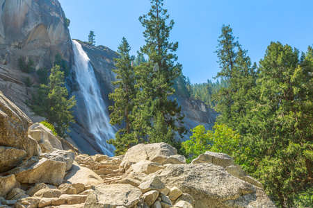 side view of Nevada Fall waterfall from Mist Trail in Yosemite National Park. Summer travel holidays in California, United States of America.