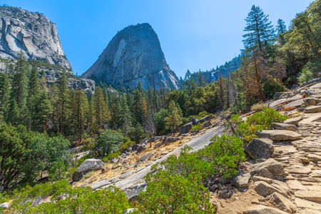 Panorama of Half Dome, Mt Broderick and Liberty Cap peaks on Mist trail in Yosemite National Park. Summer travel in California, United States of America. Stock Photo