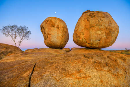 Evening at Devils Marbles: the Eggs of mythical Rainbow Serpent at Karlu Karlu - Devils Marbles Conservation Reserve. Australian Outback landscape in Northern Territory, Red Centre, Australia.