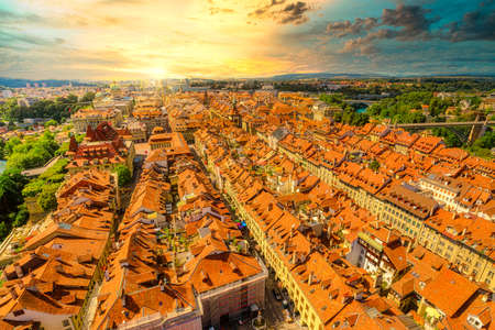 Dramatic sunset sky with clouds of Bern old town in Switzerland,