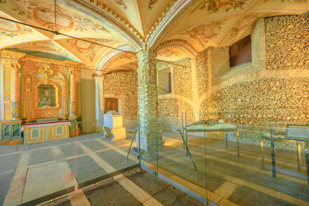 Evora, Portugal - August 18, 2017: interior of the Bones Chapel, located in the church of Sao Francisco de Assis, one of the most visited monuments of Evora in Portugal.