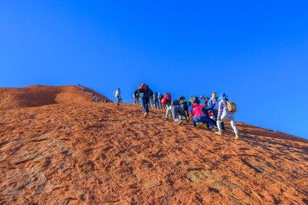 Uluru, Northern Territory, Australia - Aug 23, 2019: people climbing on Ayers Rock before 26 October 2019 when the climb will be closed. Uluru is sacred to Anangu people the owners of Uluru-Kata Tjuta. Editorial