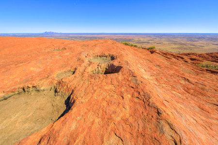 Uluru, Northern Territory, Australia - Aug 23, 2019: panoramic view from the top of Uluru-Kata Tjuta National Park. Climbing to Uluru summit. In the background Mount Olga or Kata Tjuta domed formation Editorial